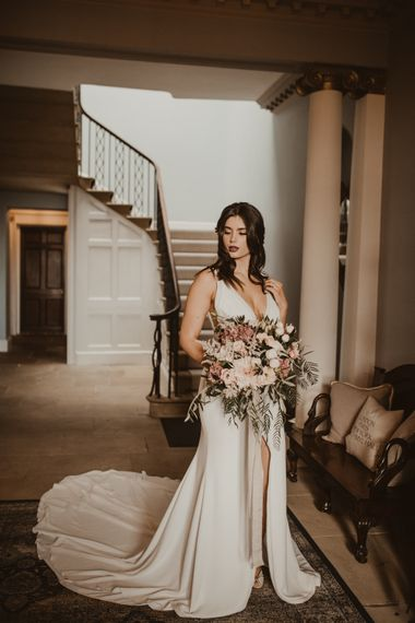 Beautiful Bride in V Neck Strap Wedding Dress with Front Split & Puddle Train | Oversized Pink & Foliage Wedding bouquet | Romantic Pink and Gold Wedding Inspiration in a Modern Summer House at Garthmyl Hall by KnockKnockPenny Studio | Nesta Lloyd Photography