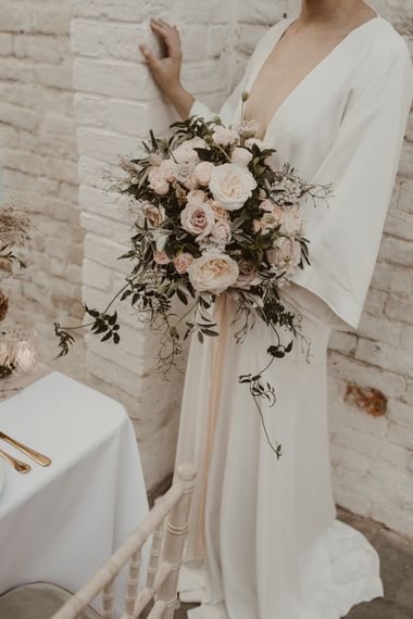 Baby Pink Rose Wedding Bouquet | Beautiful Bride in Wrap Wedding Dress & Vine Headpiece | Romantic Pink and Gold Wedding Inspiration in a Modern Summer House at Garthmyl Hall by KnockKnockPenny Studio | Nesta Lloyd Photography