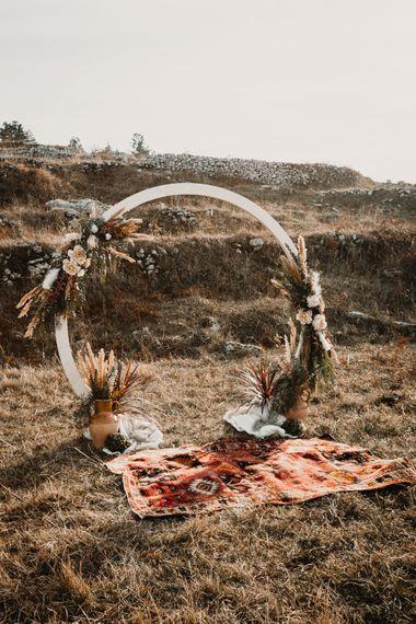 Moon Gate & Persian Rug Decor   A Wild Bohemian Bride in the Majella National Park, Abruzzo, Italy   Planned & Styled by Antonia Luzi   Federico Lanuto Photography