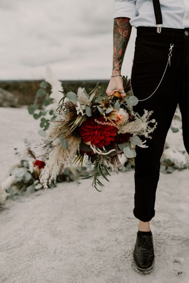 Bride in Trousers, White Shirt & Braces | Pampas Grass, Eucalyptus & Red Rose Wedding Bouquet | Horseshoe Pampas Grass, Eucalyptus & Red Rose Floral Arrangement | Wild Same Sex Couple Wedding Inspiration Shoot | Anne Letournel Photography