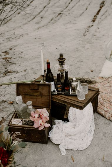 Wooden Crates, Decanters & Candle Sticks Wedding Decor | Wild Same Sex Couple Wedding Inspiration Shoot | Anne Letournel Photography