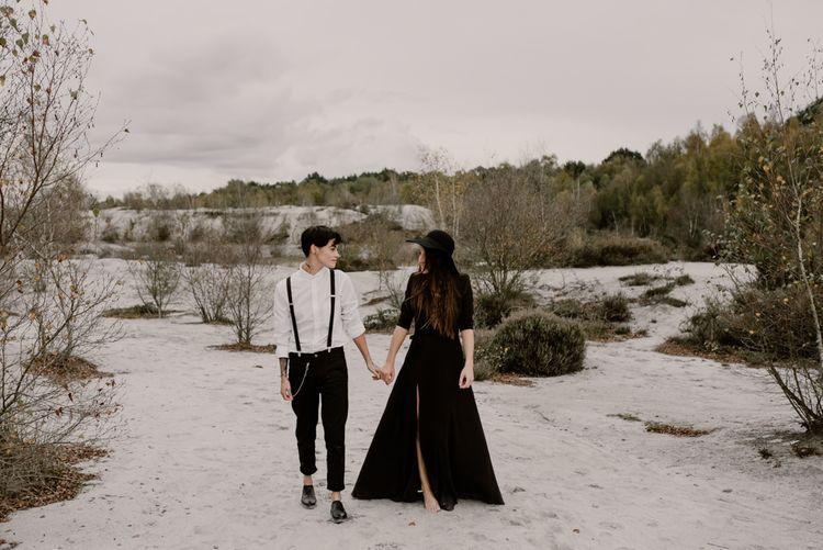 Bride in Portez Vos Idées Black Wedding Dress | Bride in Black Trousers, White Shirt & Braces | Wild Same Sex Couple Wedding Inspiration Shoot | Anne Letournel Photography
