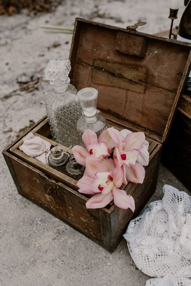 Wooden Box & Glass Decanters Wedding Decor | Wild Same Sex Couple Wedding Inspiration Shoot | Anne Letournel Photography