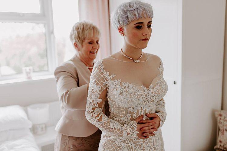 Bride getting ready on the wedding morning in a Lillian West wedding dress