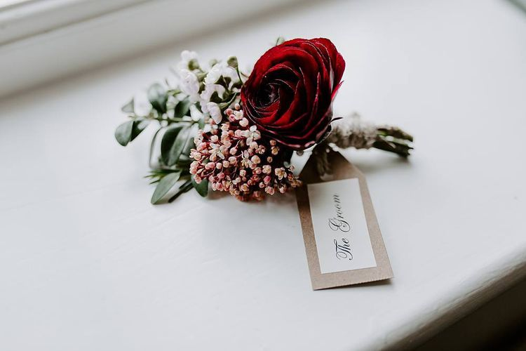 Deep pink buttonhole for the groom