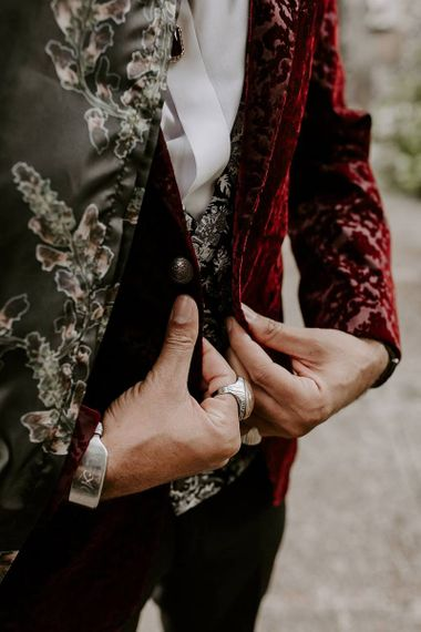 Stylish groom patterned waistcoat and pink blazer