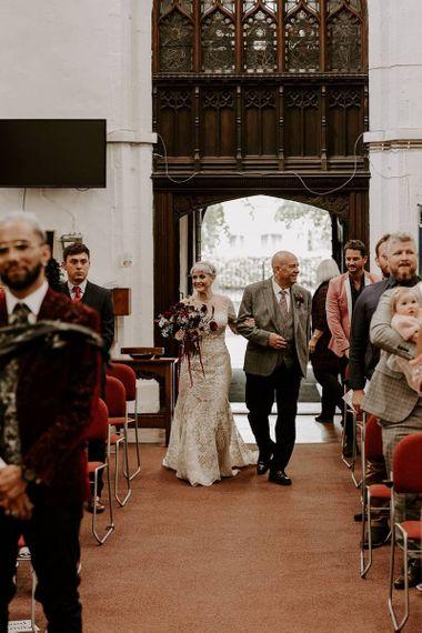 Church wedding ceremony bridal entrance in Lillian West wedding dress
