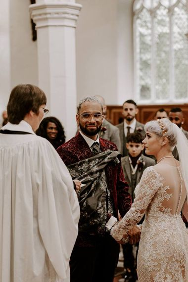 Bride and groom exchanging vows at church wedding ceremony