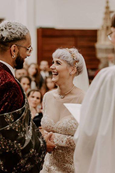 新娘和短头发and bridal crown laughing during the wedding ceremony