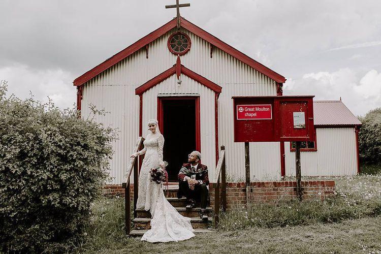 Bride in Lillian West wedding dress and groom in blazer