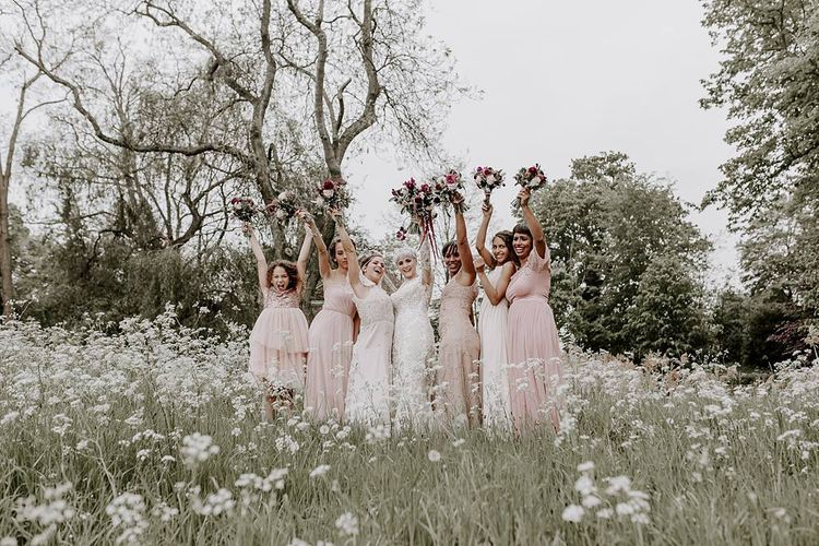 Bridal party portrait with bridesmaids in pink dresses
