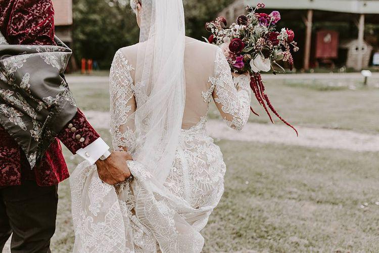 Bride in backless Lillian West wedding dress