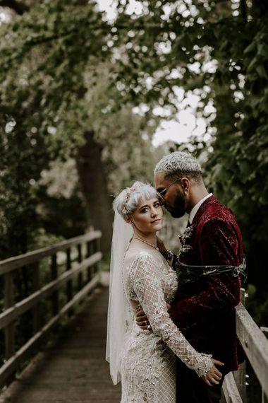 Bride in long sleeved Lillian West wedding dress