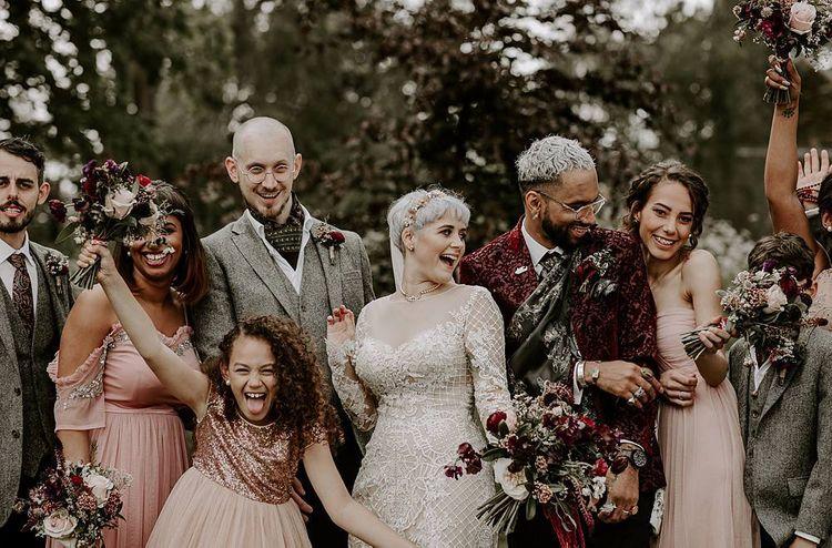 Fun wedding party portrait with bride in Lillian West wedding dress