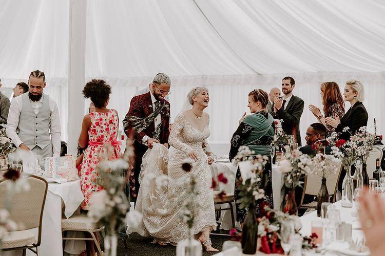 Bride and groom entering their marquee wedding reception