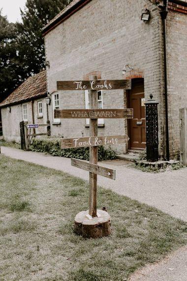 wedding direction sign post