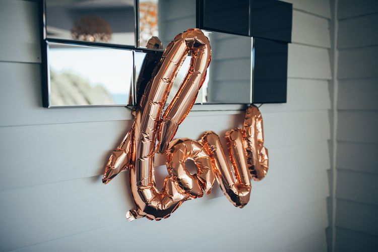 Copper Love Balloons | Wedding Reception Décor | Gypsophila Arch and Giant Balloons for an Outdoor Coastal Wedding | Toby Lowe Photography