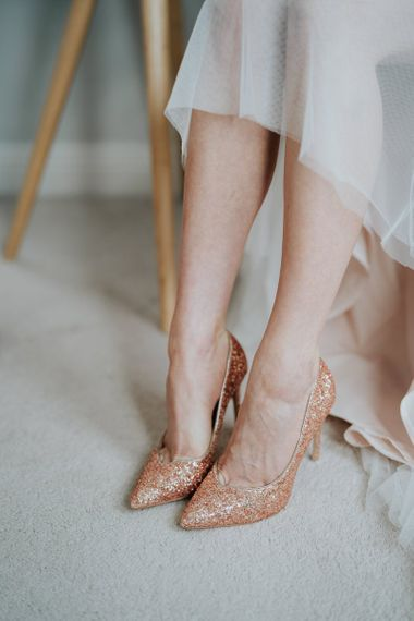 Brides glitter shoes at Oxford wedding teamed with delicate lace dress