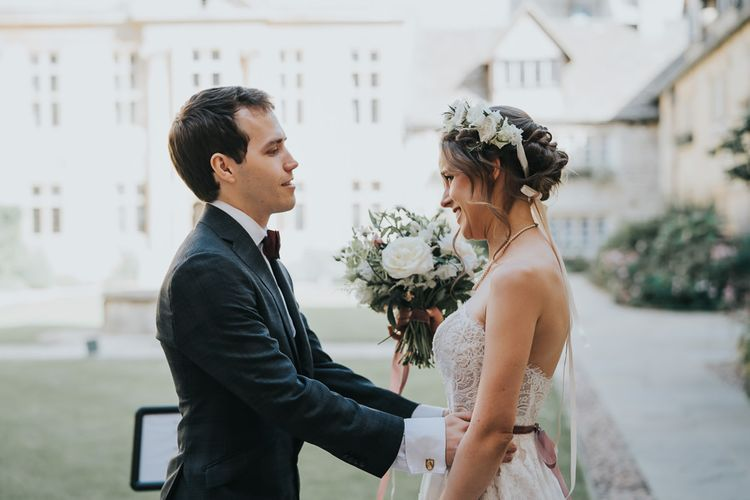 Bride and groom first look for intimate celebration with flower crown  and white floral bouquet