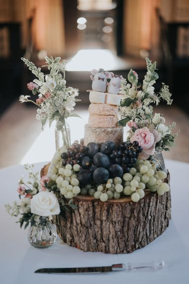 Cheese tower wedding cake served on a tree stump for classic reception at Bodleian library