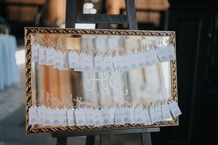 Mirror table plan with peg detail for intimate celebration with simple and classic styling