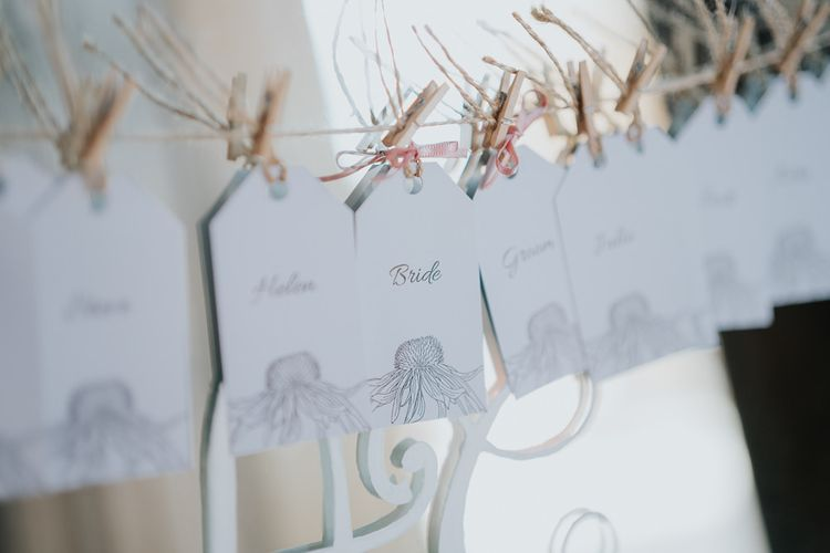 Mirror table plan with peg details for intimate celebration with simple and classic styling