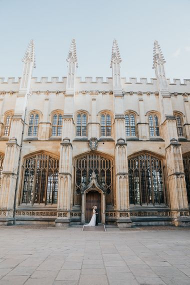 Bride and groom steal a moment at relaxed Oxford wedding reception at Bodleian library