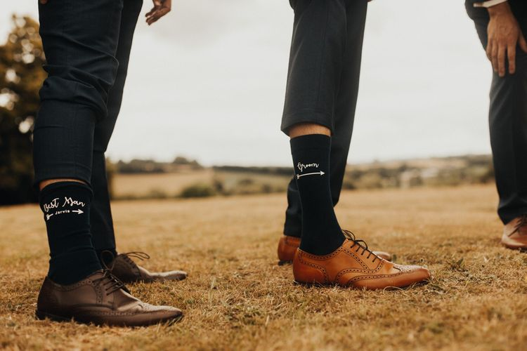 Groom in personalised socks and brown brogues