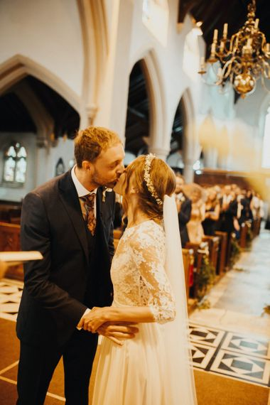 Bride and groom seal vows with a kiss