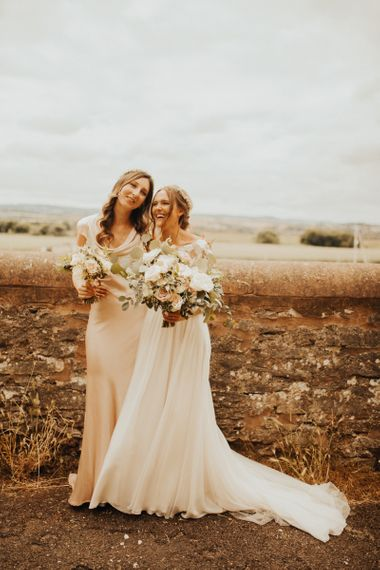 Bride with bridesmaid in pink dress