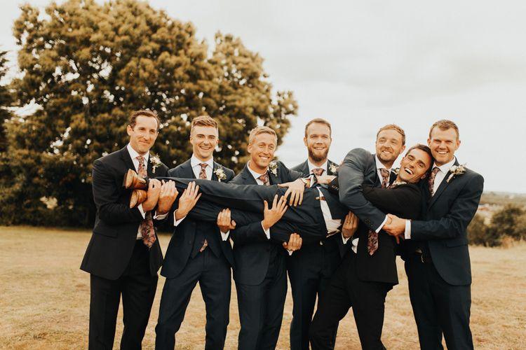 Groom and groomsmen with patterned ties