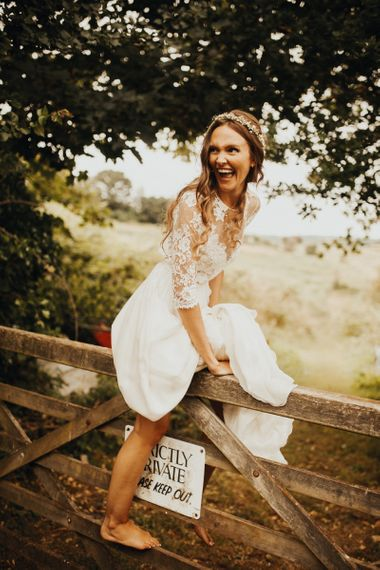 Bride in long sleeved wedding dress at flower and foliage themed day