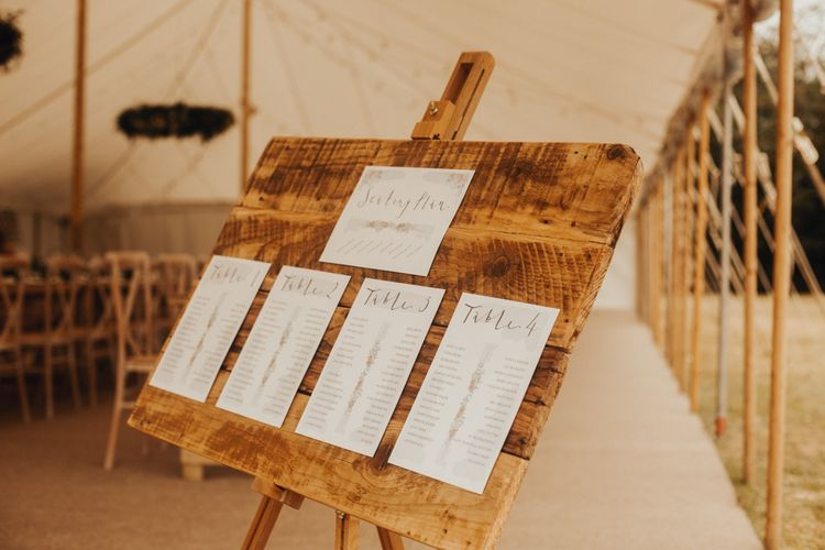 Wooden wedding signs with foliage table runner and floral chandelier