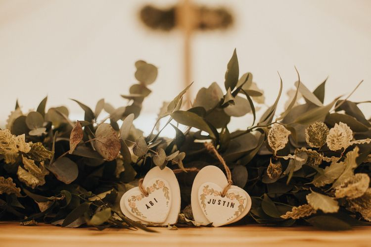 Foliage table runner with personalised heart decor