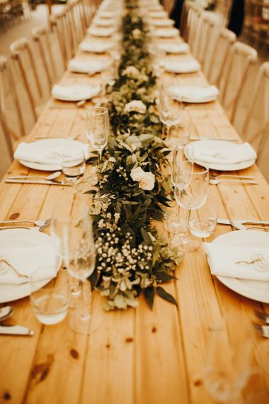 Foliage table runner with flowers on trestle tables