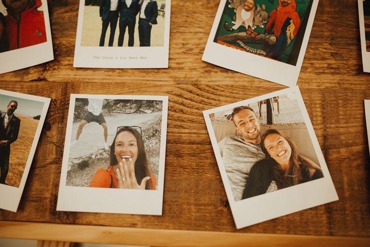 Polaroid pictures of couples love story with an abundance of flowers &  foliage table runner decor