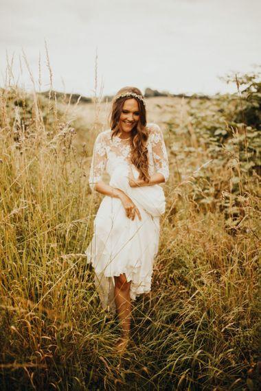 Bride wears long sleeved wedding dress with flower crown