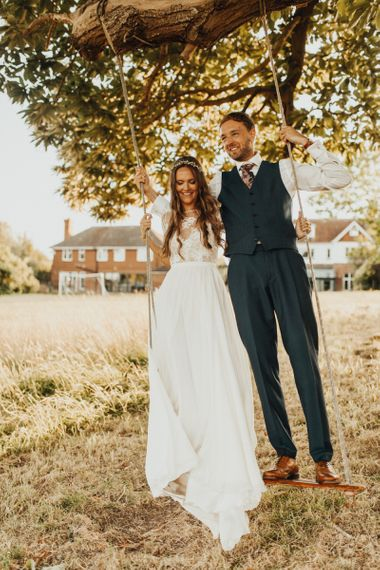 Bride and groom at family home for marquee wedding
