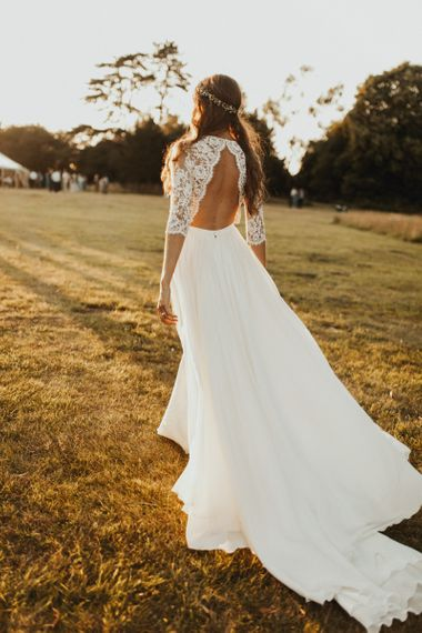 Open back lace sleeved wedding dress with flower crown