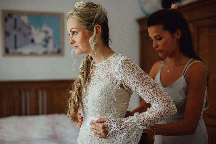 Bridal Morning Preparations | Bride in Laced Catherine Deane Wedding Dress with Long Sleeves | Loose Fishtail Plait with Gypsophilia | Homemade Hair Comb | Rustic French Destination Wedding with Homegrown Flowers  | Emily & Steve Photography