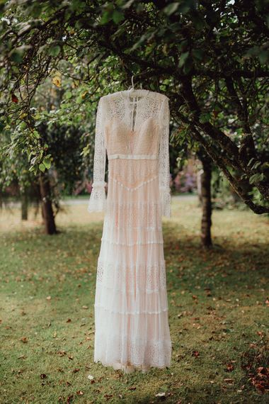 Laced Catherine Deane Wedding Dress with Long Sleeves | Rustic French Destination Wedding with Homegrown Flowers | Emily & Steve Photography