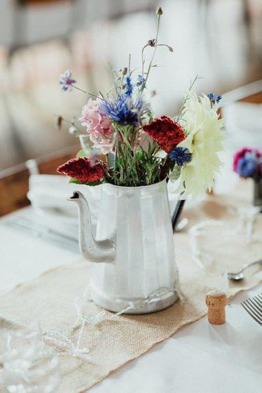 Wedding Reception Decor | Bright Flowers in Silver Tea Pot | Hessian Runner | Rustic French Destination Wedding with Homegrown Flowers  | Emily & Steve Photography
