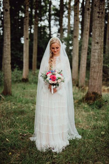 Bride in Laced Catherine Deane Wedding Dress with Long Sleeves | Loose Fishtail Plait with Gypsophilia | Homemade Hair Comb | Rustic French Destination Wedding with Homegrown Flowers  | Emily & Steve Photography
