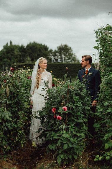 Bride in Laced Catherine Deane Wedding Dress with Long Sleeves | Groom in Blue Thomas Farthing Suit with Ochre Tie | Rustic French Destination Wedding with Homegrown Flowers  | Emily & Steve Photography
