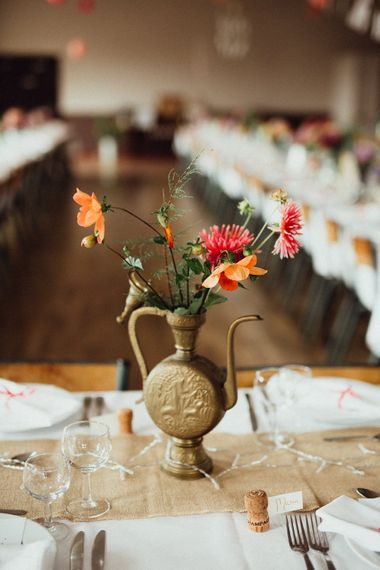 Wedding Reception Decor | Bright Flowers in Gold Vessel | Hessian Runner | Rustic French Destination Wedding with Homegrown Flowers  | Emily & Steve Photography