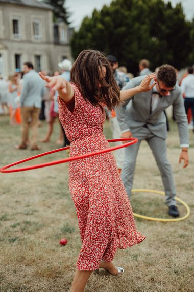 Garden Party Reception | Wedding Guest Doing Hula Hoop | Rustic French Destination Wedding with Homegrown Flowers  | Emily & Steve Photography