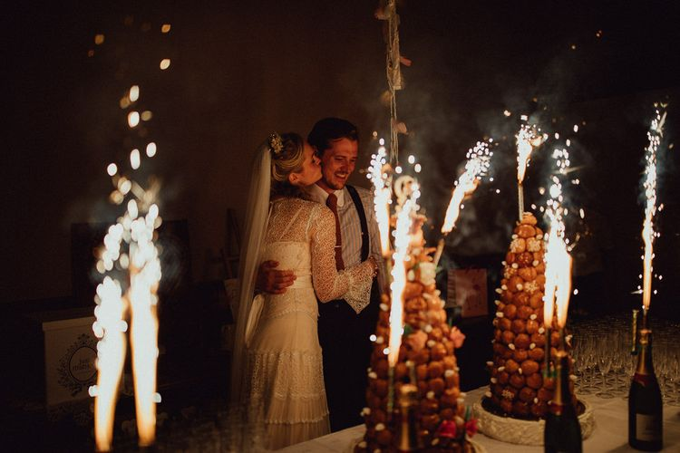 Croquembouche Cakes | Bride in Laced Catherine Deane Wedding Dress with Long Sleeves | Groom in Blue Thomas Farthing Suit with Ochre Tie | Rustic French Destination Wedding with Homegrown Flowers  | Emily & Steve Photography