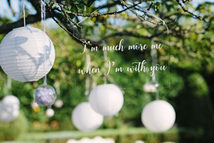 White Calligraphy Perspex Hanging Quote Wedding Sign | Classic Pink & White Wedding at Northbrook Park, Surrey | Tell Your Story Photography | Yours Truly Wedding Films