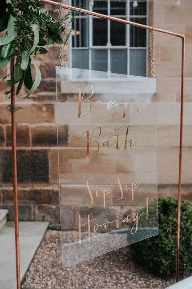 Calligraphy Acrylic Wedding Sign  on Copper Frame | Pink Roll Top Booze Bath and Copper & Perspex Wedding Decor at Industrial Venue The West Mill | Rosie Kelly Photography