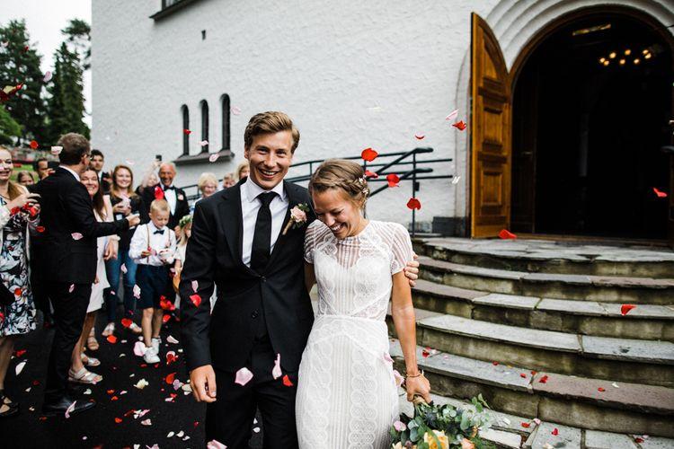 Confetti Exit | Bride in Lace Watters Wtoo Lenora Wedding Dress | Groom in Black Tie Suit | Woodland Wedding in Oslo, Norway | Through The Woods We Ran